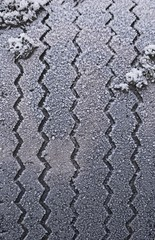 Frost-covered car tire, detail showing tread