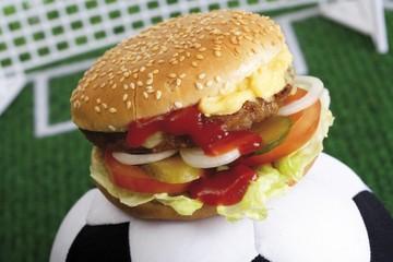 Football fast food - hamburger on a football