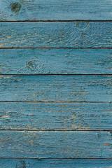 Vintage wood background with blue peeling paint.
