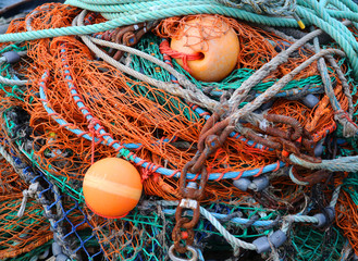 Close Up Pile of Colorful Fish Nets and Buoys