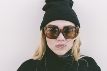 cool young woman with big sunglasses