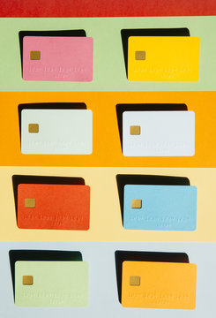 Eight blank credit cards on striped background
