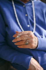 Hand of a senior woman holding a cigarette
