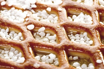 Gitterapfelkuchen or Grid Apple Pie covered with decorative coarse sugar