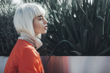 Young beautiful woman with white hair outdoors
