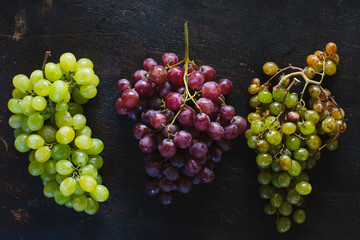 Grapes still life on wooden table