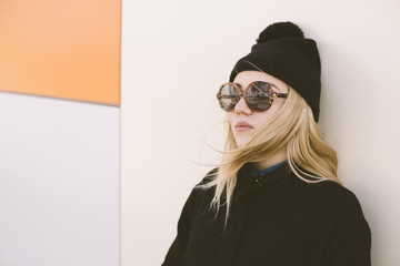 cool young woman with round sunglasses