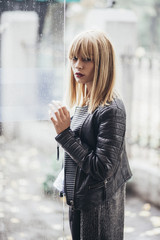 Young beautiful fashionable woman with blond hair