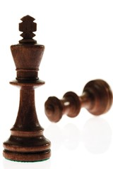 Checkmate: king and toppled queen chess pieces