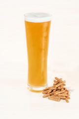 Glass, pint and bottles of beer isolated on a white background