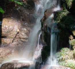 waterfall with a abstract rock face