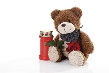 Teddy bear and a grave candle