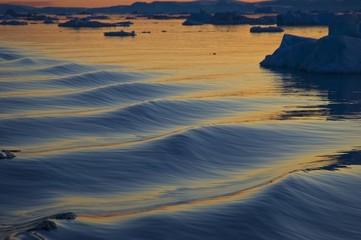 Waves at dusk, icebergs, Kangia Fjord, Jakobshaven, Ilulissat, Greenland, North America