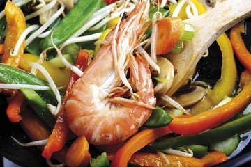 Wok dish: shrimp, button mushrooms, bell peppers, snow peas, carrots, celery, zucchini and bean sprouts