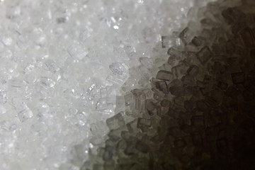 Sugar crystals close-up photo background.