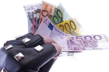 Black leather-gloved hand holding fanned Euro bills