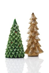 Golden and green candle, shaped as fir trees