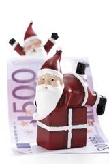 Santa Claus figure on gift with Euro bills - symbol for Christmas bonus