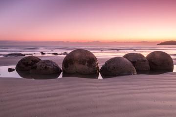 Aluminium Prints New Zealand Moeraki Boulders at pink sunrise
