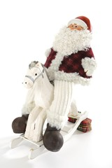 Santa Claus figuring on a rocking horse, Christmas decoration