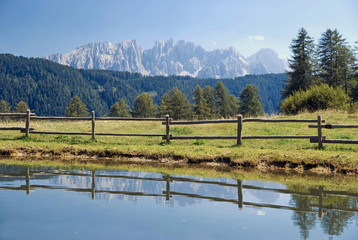 Reflection of the Latemar massif near Tiers, South Tyrol, Italy, Europe