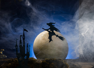 Halloween witch flying on broomstick,   Halloween background.
