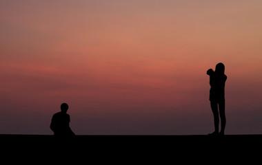 Silhouette of Female Photographer.