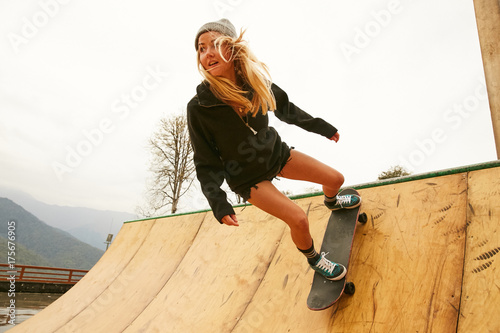a girl doing skateboarding on a ramp on a rainy weather. Black Bedroom Furniture Sets. Home Design Ideas