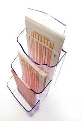 Bank forms in a plastic holder