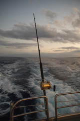 Poster Arctica Deep Sea Fishing Reel on a boat during sunrise