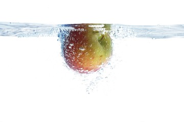 Apple dunked into water