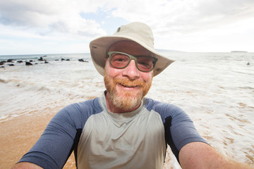 Happy man selfie at the beach