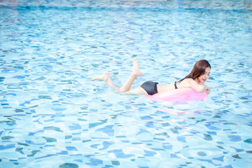 Young woman in the swimming pool,woman asia thailand