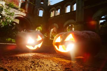Evil grins of jack-o-lanterns burning on halloween night