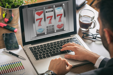 Slot machine on a laptop screen. 3d illustration