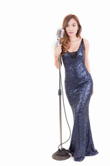 Full-length portrait of  singer wearing blue dress and keeping static mic, isolated on white. Concept asian woman of  music.