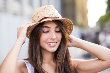 cheerful young woman looking down