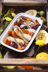 pumpkin baked with chicken. autumn vegetables. tray with food.