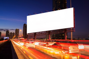 Blank billboard on light trails, street, urban and city in the twilight, night - can advertisement for display or montage product or business.