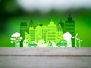Eco city concept on green background