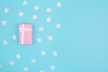 Gift box on colorful background.