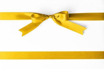 Gold satin ribbon stripe fabric bow isolated on white background with clipping path