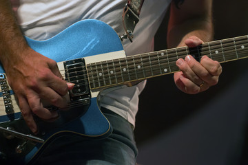 Guitar player in concert