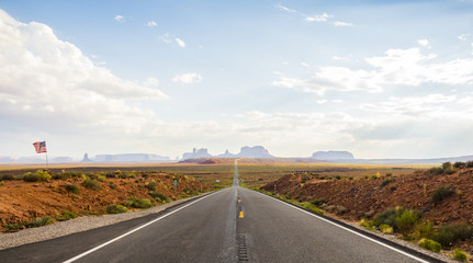 Forest Gump Point with Navajo American flag - Monument Valley scenic panorama on the road - Arizona, AZ, USA