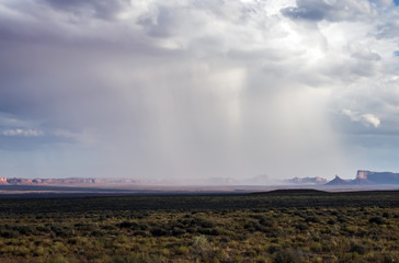 Isolated rainstorm at the Monument Valley with - View from US Hwy 163, Monument Valley, Utah, USA