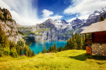 Great panorama of the azure pond Oeschinensee. Location Swiss alps, Kandersteg, Europe.