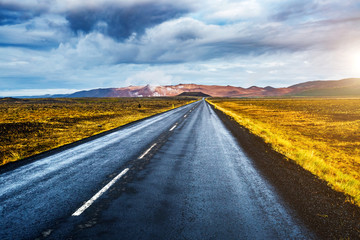 Empty road leading to geothermal area Hverir (Hverarond) near Lake Myvatn. Location Iceland, Europe.