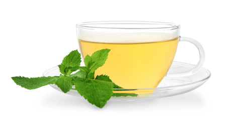 Cup of mint tea on white background