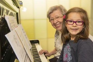 Grandma and Kid Playing the Piano