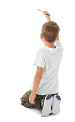 Talented boy painting on white background